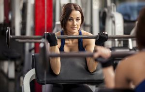 woman-barbell-gym-weight